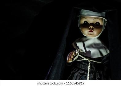 creepy nun doll looking in high contrast concept