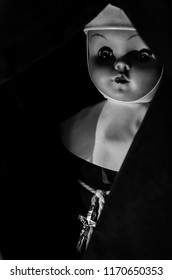 creepy nun doll smile in black and white and high contrast concept