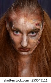 Creepy portrait of a halloween girl with artistic make up