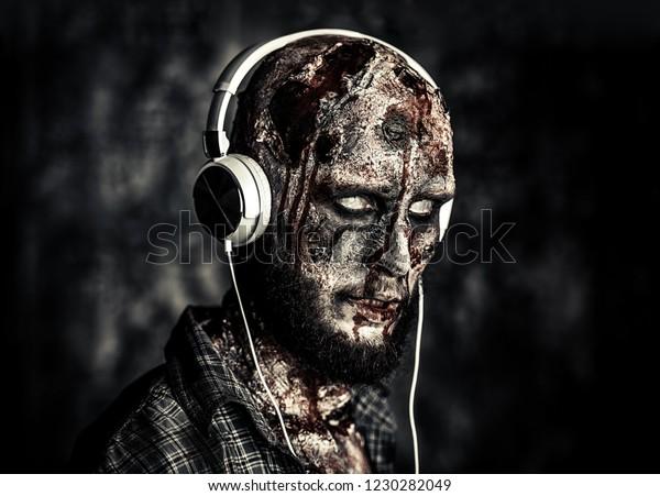 Creepy Scary Zombie Listening Music Headphones Stock Photo