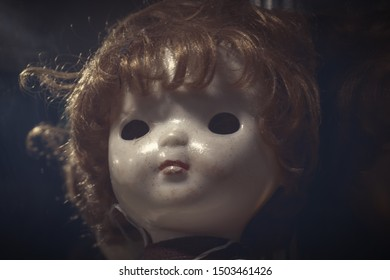 Creepy sinister old broken dirty abandoned dolls as halloween concept.