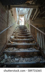 Creepy stairway in an abandoned building