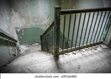 Creepy stairwell in an abandoned hospital
