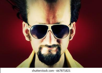 A creepy ugly man's portrait, big forehead, dark eyeglasses.