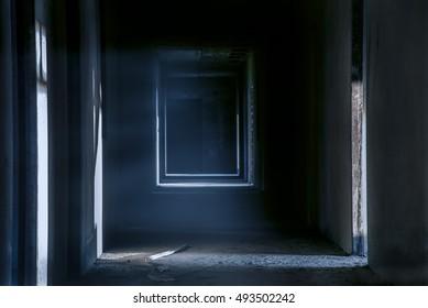 Creepy walkway hallway in abandoned building, darkness horror night