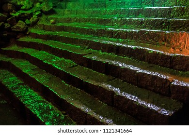 Creepy wet stone stairs inside of a cave