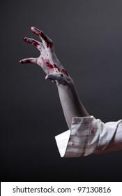 Creepy zombie hand, extreme body-art, studio shot