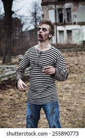 Creepy zombie sailor walking in abandoned village