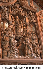 Creglingen (Germany). April 2017. Church of the Body of Christ. Wooden altar made by sculptor Riemenschneider.The farmer, processing the field, found the prosphora-symbol of the Body of Christ.