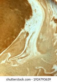 crema of hot espresso coffee mix with stream hot milk foam in the coffee cup