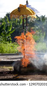 cremation process, burning dead body, traditional funeral ceremony on Bali, Indonesia