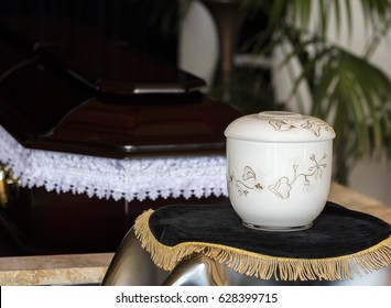Cremation urn in front of coffin,