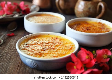 Creme brulee, french traditional dessert, three portions. Rustic style