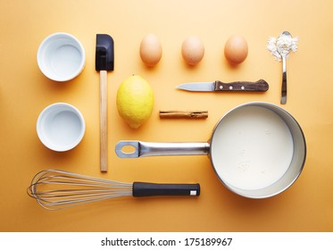 Creme brulee ingredients on yellow background unusual presentation
