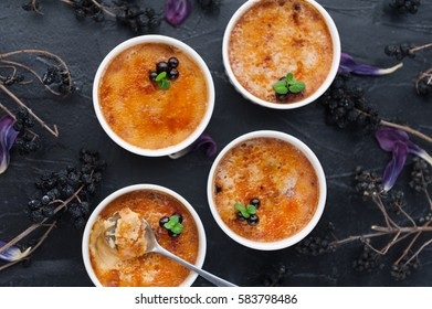 Creme brulee in a white bowl with sugar crust. Studio photography. country style.