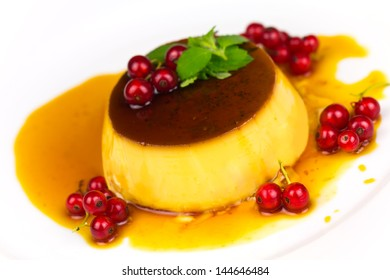 Creme Caramel with red Currants, isolated on White