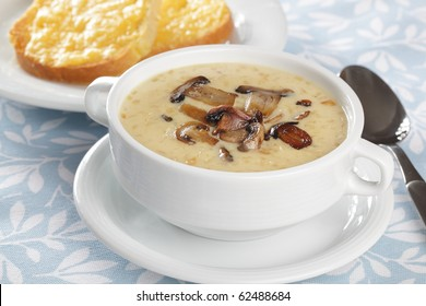 Creme soup with mushrooms in white bowl