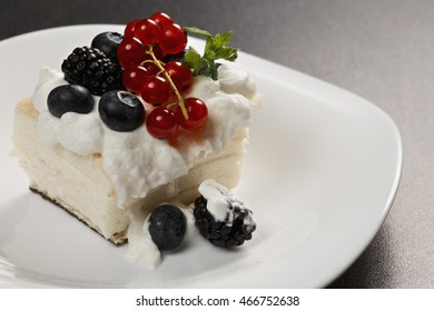 Cremeschnitte vanilla and custard cream cake dessert decored with berries closeup