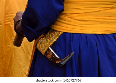 """Cremona, Italy - April 13, 2019: sikh man participating  to Vaisakhi festivity; detail of the dagger called """"kirpan"""""""