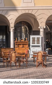 CREMONA, ITALY -FEBRUARY 17: vintage furniture on sale in street at flea market, shot in bright winter light on feb 17, 2019 at Cremona, Lombardy, Italy