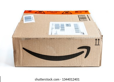 CREMONA, ITALY - MARCH, 2019: cardboard box isolated on white background from Amazon. Amazon Prime is a fast paid delivery service.