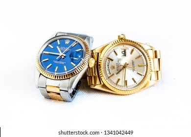 CREMONA, ITALY - MARCH, 2019: Rolex Day- Date and Oyster Blue watch on white background. Rolex SA is an important Swiss company in the production of fine wrist watches, founded in London, England 1905