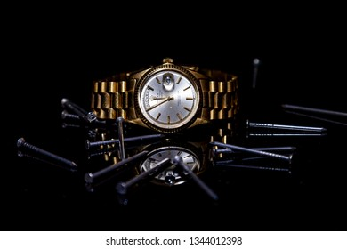 CREMONA, ITALY - MARCH, 2019: Rolex Day- Date watch on black background. Rolex SA is an important Swiss luxury company in the production of fine wrist watches, founded in London, England in 1905