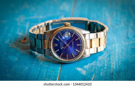 CREMONA, ITALY - MARCH, 2019: Rolex Oyster Blue watch on black background. Rolex SA is an important Swiss luxury company in the production of fine wrist watches, founded in London, England in 1905