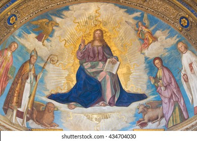 CREMONA, ITALY - MAY 24, 2016: The fresco of  Redeemer with Cremona's Patron Saints in main apse in Cathedral of Assumption of the Blessed Virgin Mary by Boccaccio Boccaccino (1506).