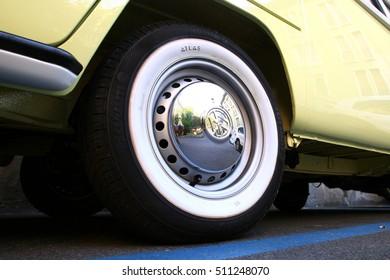 Cremona, Italy - September 10,2016: Tyre of an old restored Yellow Volkswagen van parked in Cremona on September 10,2016