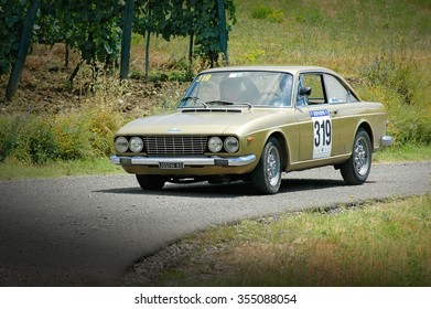 Cremona / Italy -  September 7, 2005 - Unidentified drivers on a gold vintage Fiat 124 coupe racing car