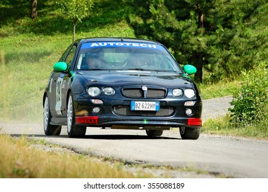 Cremona / Italy -  September 7, 2005 - Unidentified drivers on a black vintage MG ZR racing car