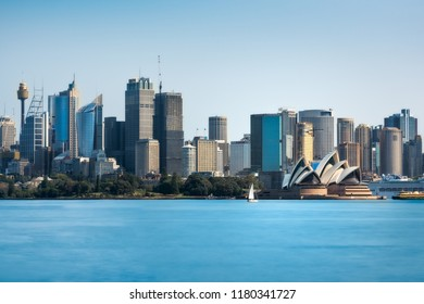 Cremorne Point, Sydney, Australia - September 11, 2018: Daytime View from Cremorne Point of City Skyline in Sydney Harbour with Opera House and the Royal Botanic Gardens.
