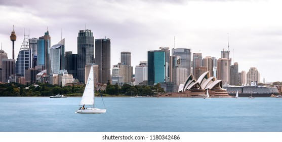 Cremorne Point, Sydney, Australia - September 11, 2018: Sydney Harbour View from Cremorne Point with Opera House and City Skyline in the backgound and a sail boat in the foreground.