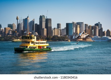 Cremorne Point, Sydney, Australia - September 11, 2018: A ferryboat in Sydney Harbour - Daytime View from Cremorne Point with Opera House and City Skyline with a ferryboat in the foreground.