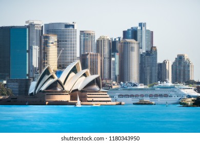 Cremorne Point, Sydney, Australia - September 11, 2018: City Skyline in Sydney Harbour - Close up View from Cremorne Point with Opera House and a cruiser in Sydney Harbour, Australia.