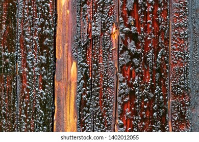 Creosote soaked power transmission pole with bubbles