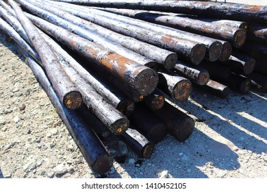Creosote treated wood that will be used as utility poles.This treatment will protect the poles from th elements and from pests such as termites.