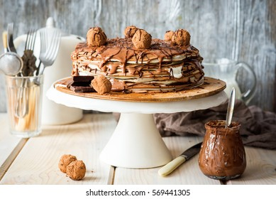 Crepe cake with chocolate spread and vanilla cream and truffles