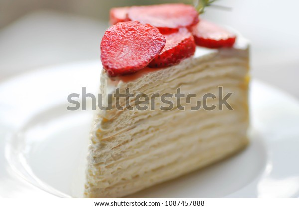 crepe cake with strawberry topping or strawberry crepe cake