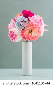 Crepe paper flower bouquet with peonies, hyacinth, garden rose and poppies in a vase
