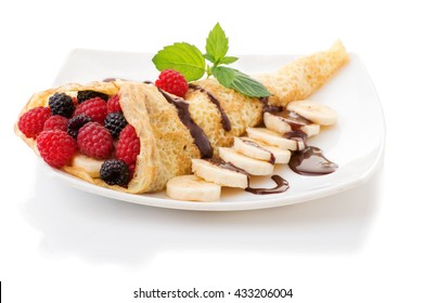 Crepes With Berries and cup of coffee. Crepe with Raspberry, Blueberry and Chocolate topping.