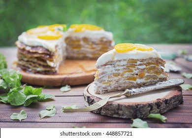 Crepes cake with peaches and cream