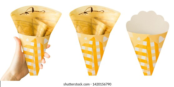 Crepes with Chocolate Sauce Isolated on White Background for Food Snack. Fresh Homemade Golden Pancake Dessert Top View. Woman is Hand Holding Brown Crepe Baked for Dessert Breakfast. Clipping Path.