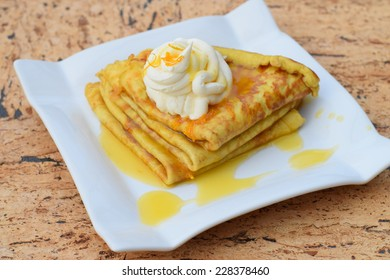 Crepes with orange sauce and whipped cream