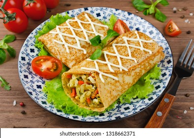 Crepes stuffed with stewed cabbage with carrots and eggs. Traditional Russian food.