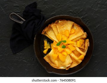 Crepes Suzette. Pancakes with orange compote.