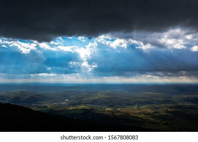 Crepuscular rays breaking between the clouds