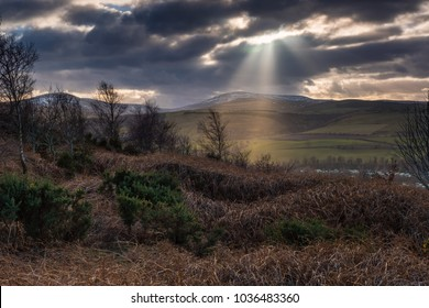 Crepuscular Rays over the Cheviot Hills, the sunbeams near Wooler a small market town in Northumberland, England which lies at the edge of Northumberland National Park in the foothills of the Cheviots