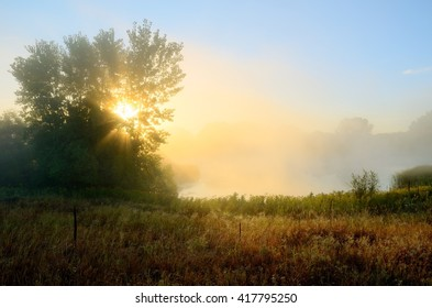 Crepuscular Rays Through the Fog Near a Pond by the Rice Creek North Regional Trail in Shoreview, Minnesota